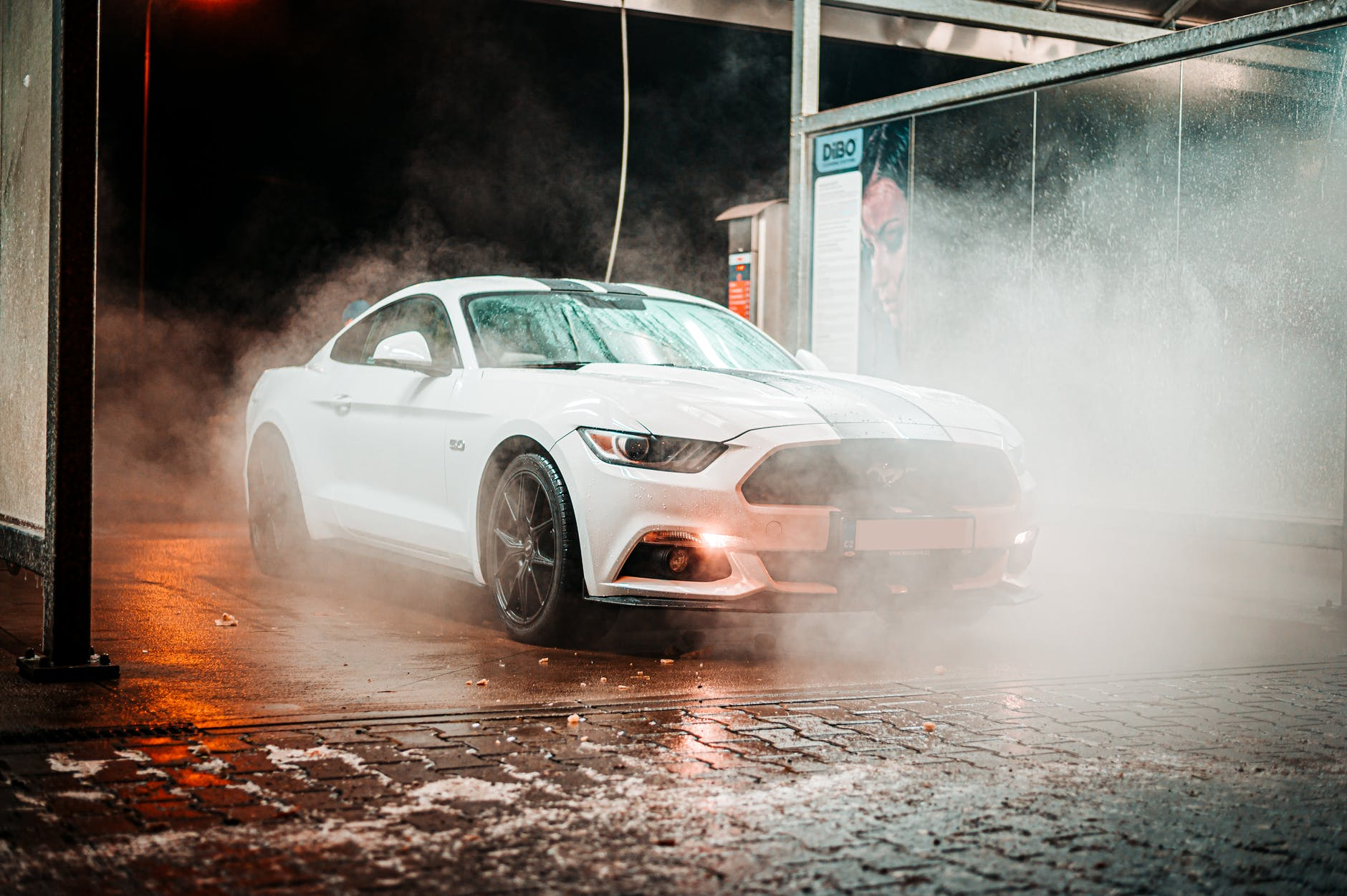 parked white coupe during night