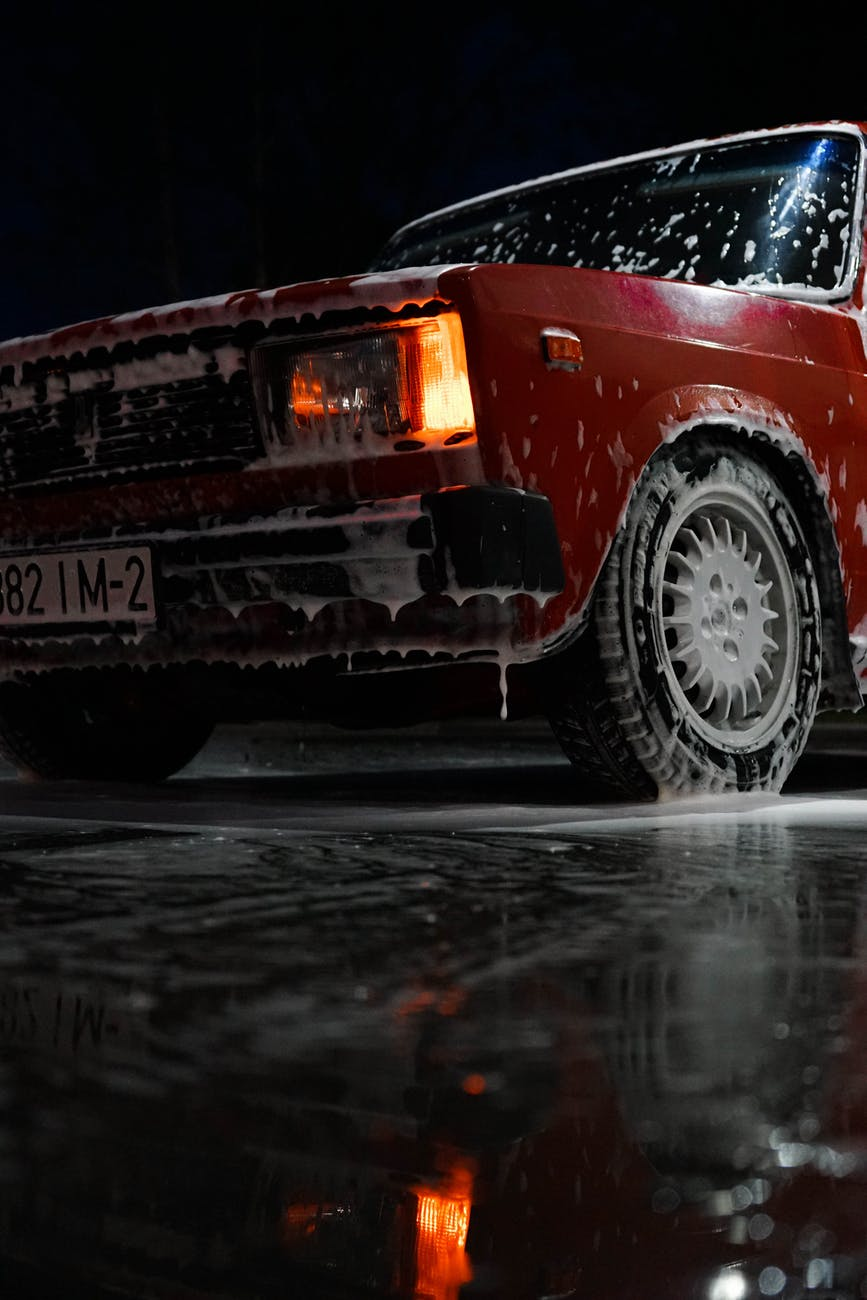 red car soaked with soap